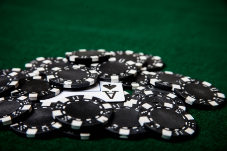 Ace under black poker chips Stock Photo