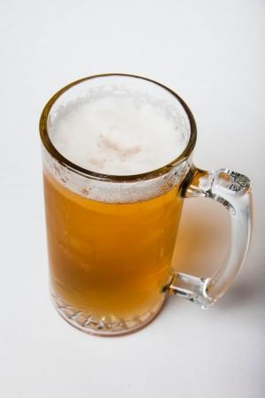 Beer in mug on white
