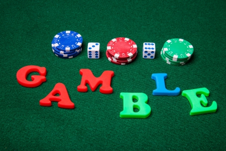 Gamble letters with poker chips and dice