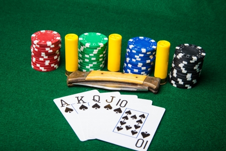 Royal Flush with chips and knife
