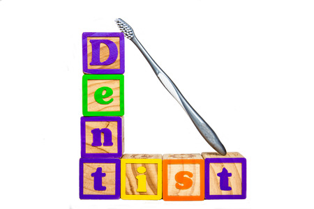 Black spelling dentist with a toothbrush