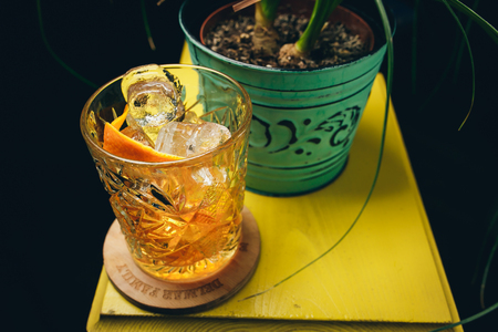 old fashioned classic cocktail in crystal glass