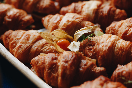 Close Up Fresh Croissants With Salad, Ham And Cheese On Table Reklamní fotografie