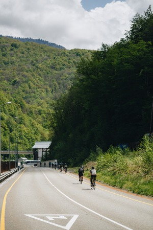 cyclists on the mountain road.
