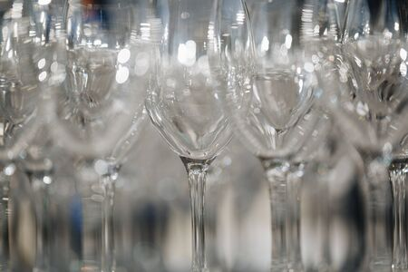 Empty wine glasses closeup. In a row, focus on foreground.