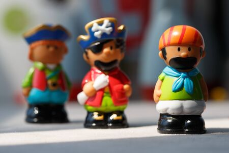 colored toys pirates on blurred background large Plenum Banque d'images