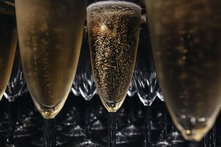 Close-up the glasses of the champagne on a table. Reklamní fotografie