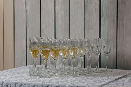 glasses of white sparkling wine champagne lot of close-ups.