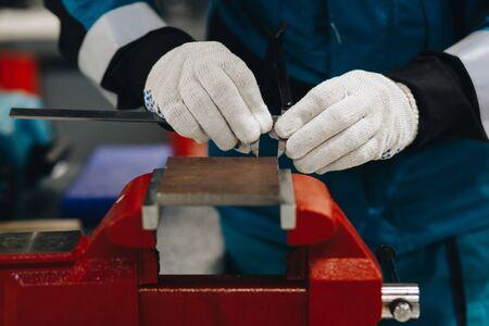 Locksmith working on a vise. Stock fotó