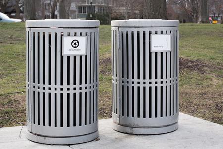 botes de basura: Trash cans in a park Foto de archivo