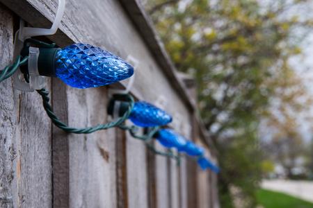 Blue lights on a fence