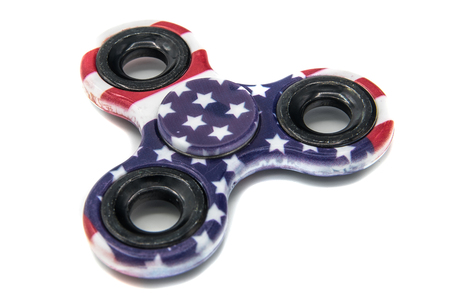 Fidget spinner with an american flag on a white background