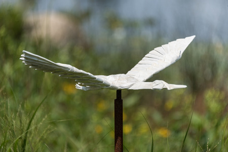 Big origami crane in a botanic garden