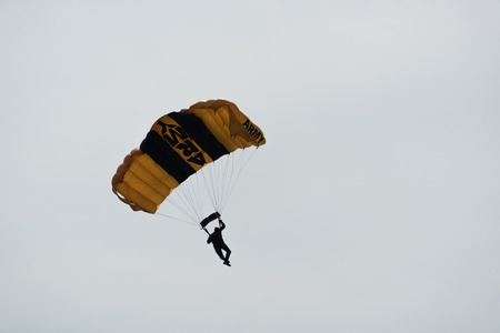 Parachutist in the sky on a cloudy day Editorial