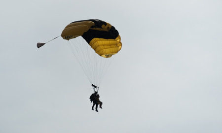 Parachutist in the sky on a cloudy day Stock Photo