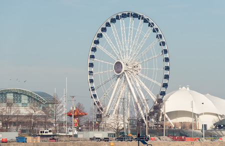 Huge blue and white Ferris wheel in a city Editorial