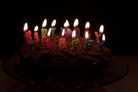 Chocolate birthday cake with candles on it Stock Photo