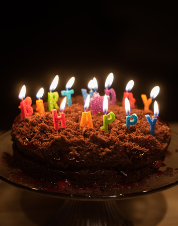 Chocolate birthday cake with candles on it Stock fotó