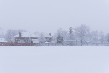 Suburban school field in a park under a heavy winter snow