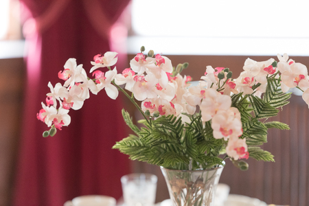 Beautiful pink flowers in a vase on a table
