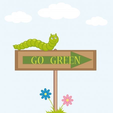 green caterpillar sits on the sign  go green