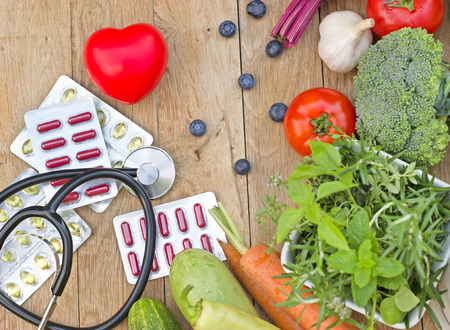 stethoscopes: Healthy diet - concept of healthy nutrition with suplements Stock Photo