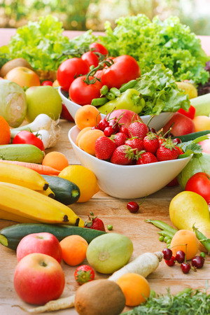 Organic fruits and vegetables on table