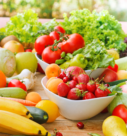 eating fruit: Organic fruits and vegetables Stock Photo