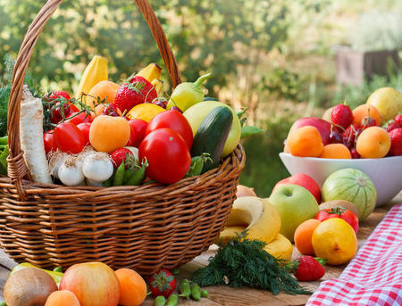 Wicker basket full of fresh fruits and vegetables Reklamní fotografie