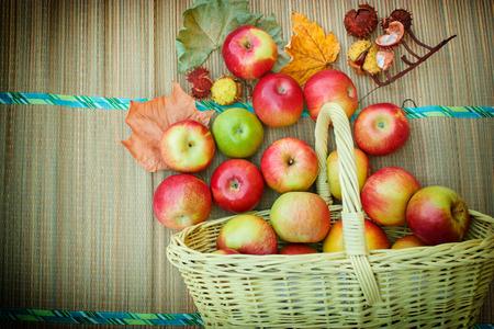 wicker basket: Autumn fruit in a wicker basket
