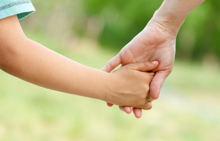 hold: Mothers love in the hand, on the palm Stock Photo