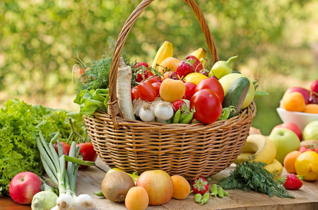 Wicker basket full of fresh fruits and vegetables Stok Fotoğraf