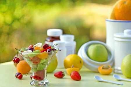 healthier: Fruit salad is rich with vitamins - healthier than synthetic vitamins, your choice ! Stock Photo