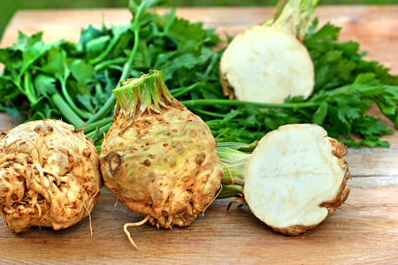 roots: Organic celery root celery and leaves of celery