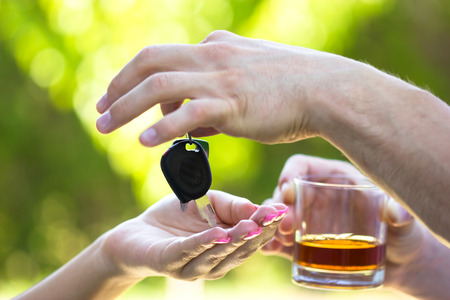 car driving: Do not drink when you drive Stock Photo