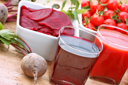 juice fresh vegetables: Healthy drinks healthy juices - beet and tomato juice Stock Photo