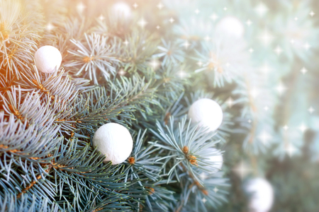 green and white: Christmas decoration - Christmas ball on Christmas tree Stock Photo