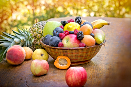 fruits in a basket: Fresh organic fruits in wicker basket Stock Photo