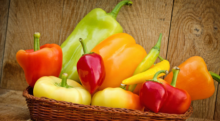 organic peppers: Organic peppers in wicker basket