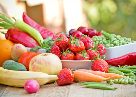 raw food: Fresh fruits and vegetables on a table - healthy diet