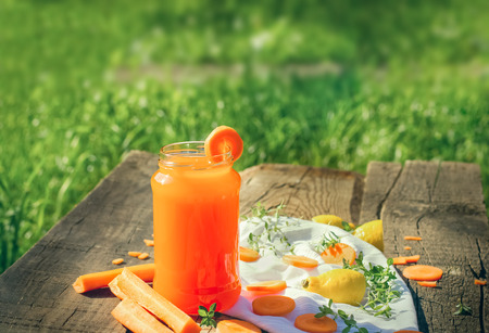 carrot juice: Carrot juice in jar - refreshing drink on rustic table Stock Photo