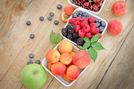 brambleberry: Healthy fruits in bowl on table - organic fruits
