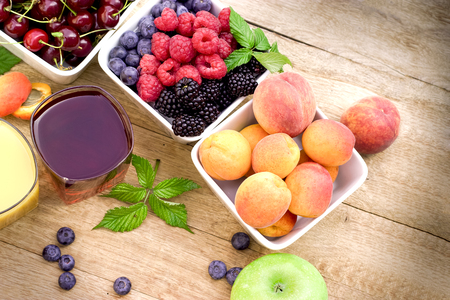 brambleberry: Organic fruits and fresh juices on rustic wooden table Stock Photo