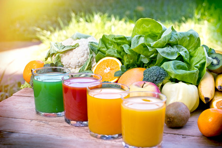 Organic fruits and vegetables are the basis for healthy smoothies and juices Фото со стока - 64023433