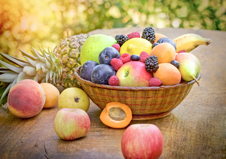 Different organic fruits in the diet contributes to your health Stock Photo