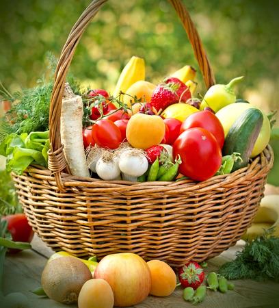 Fresh organic fruit and vegetable in wicker basket