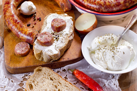 smoked sausage: Homemade dried, smoked sausage for an appetizer or a delicious meal - organic meat Stock Photo