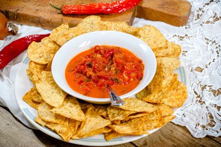 freshly prepared: Nachos and salsa on table closeup - freshly prepared appetizer