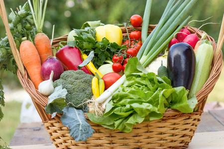 Fresh seasonal organic vegetable in wicker basket Stock Photo - 75101148
