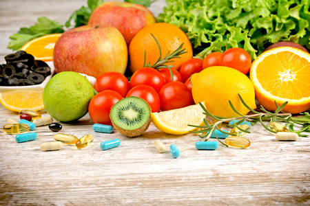 Healthy eating (diet) and healthy lifestyle with fresh organic fruit, vegetable and supplement (additive in healthy eating, diet) Stock Photo